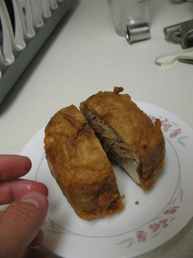 More deep-fried things.  There is such a variety.  Here I selected a HUGE stuffed tofu.  I cut it in half.