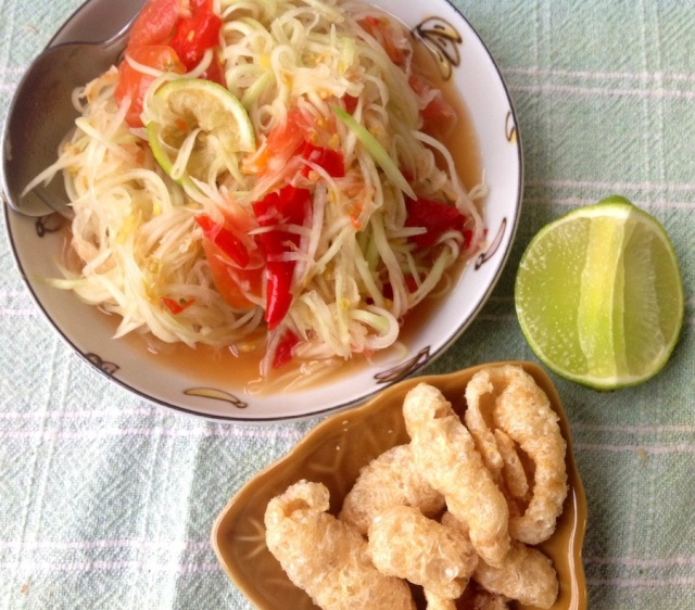 Papaya salad, with a side of pork cracklings