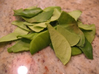 Shred kaffir lime leaves by taking out the central stem