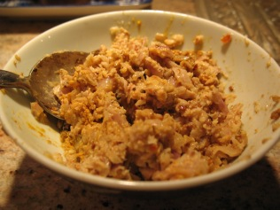 After the paste is pounded (relatively) smooth, mix with tumeric and shrimp paste in a bowl