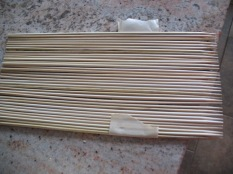 flatten a bunch of bamboo skewers. Line up their points. Tape them from the top first, then flip over. This can now be used to wrap around a core of a few skewers wrapped with a buffer of paper towels