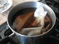 spices in the bag, soy sauce and shaoxing rice wine added to water to cover pork belly chunks