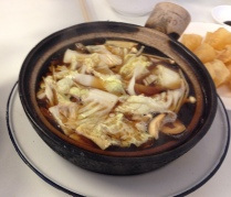 I had one with cabbage and enoki mushrooms. Notice the dark soup--and you can just see the batonggo off to the side