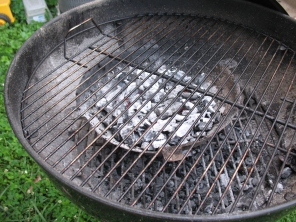 The top grate fits right over the coals