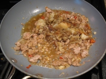 Season the pork with all of the ingredients and finish by tossing in the chopped eggplant
