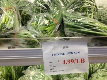 "蒜蕊 suanrui at Spring Garden Supermarket, and here confusingly called ""Chinese leek sum"" in English"